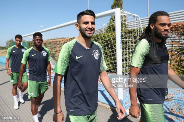 Riyad Mahrez of Manchester City arrives with team mates to take part in his first training session at Manchester City Football Academy on July 11...