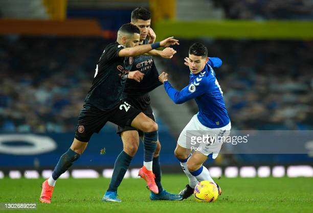 Riyad Mahrez of Manchester City battles for possession with James Rodriguez of Everton during the Premier League match between Everton and Manchester...