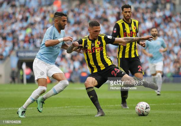 Riyad Mahrez of Manchester City battles for possession with Jose Holebas of Watford during the FA Cup Final match between Manchester City and Watford...