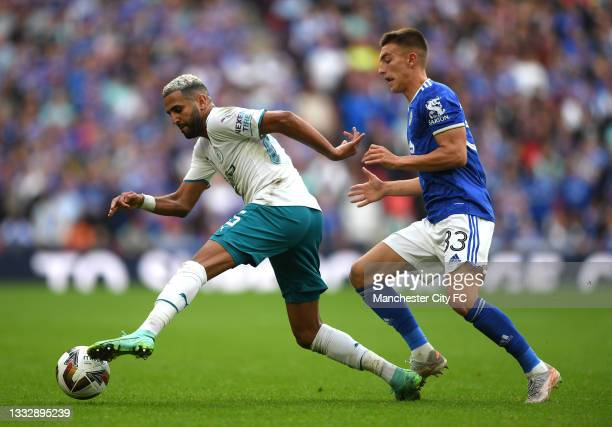 Riyad Mahrez of Manchester City battles for possession with Luke Thomas of Leicester City during The FA Community Shield Final between Manchester...