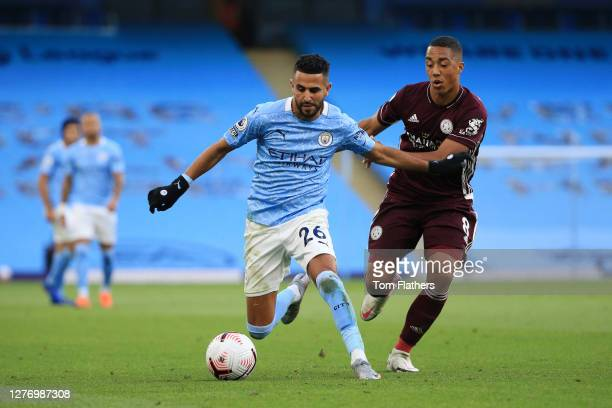 Riyad Mahrez of Manchester City battles for possession with Youri Tielemans of Leicester City during the Premier League match between Manchester City...