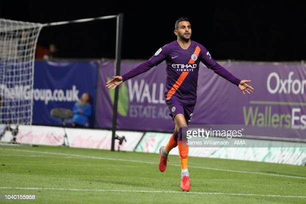 Riyad Mahrez of Manchester City celebrates after scoring a goal to make it 20 during the Carabao Cup Third Round match between Oxford United and...