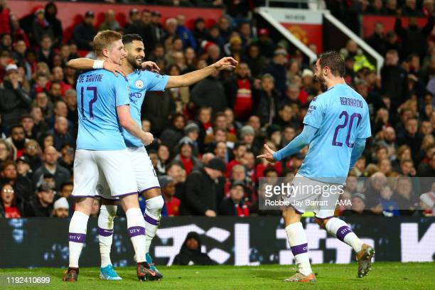 Riyad Mahrez of Manchester City celebrates after scoring a goal to make it 02 with Kevin De Bruyne and Bernardo Silva during the Carabao Cup Semi...