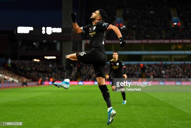 Riyad Mahrez of Manchester City celebrates after scoring his sides first goal during the Premier League match between Aston Villa and Manchester City...