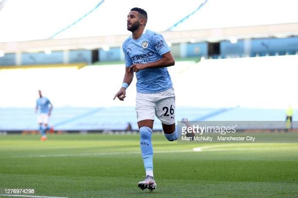 Riyad Mahrez of Manchester City celebrates after scoring his sides first goal during the Premier League match between Manchester City and Leicester...