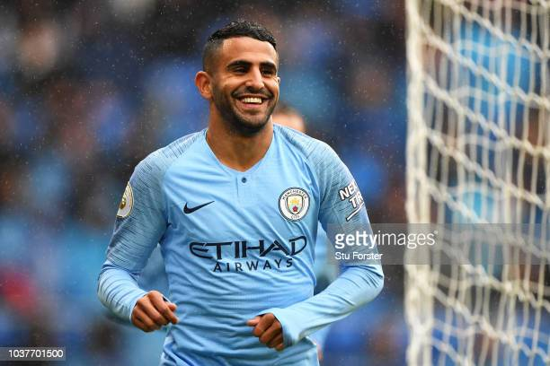 Riyad Mahrez of Manchester City celebrates after scoring his team's fourth goal during the Premier League match between Cardiff City and Manchester...