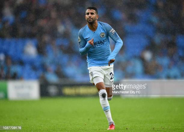 Riyad Mahrez of Manchester City celebrates after scoring his team's fifth goal during the Premier League match between Cardiff City and Manchester...