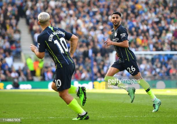 Riyad Mahrez of Manchester City celebrates after scoring his team's third goal during the Premier League match between Brighton Hove Albion and...