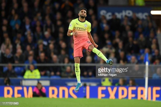 Riyad Mahrez of Manchester City celebrates after scoring his team's second goal during the Premier League match between Everton FC and Manchester...