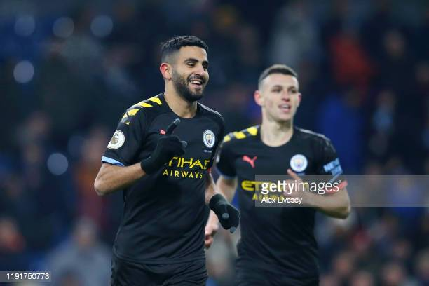 Riyad Mahrez of Manchester City celebrates after scoring his team's fourth goal during the Premier League match between Burnley FC and Manchester...