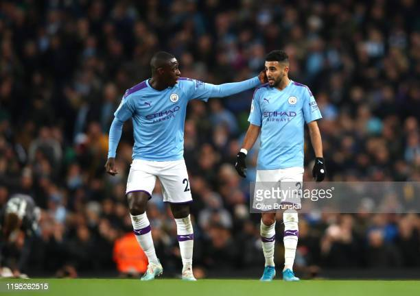 Riyad Mahrez of Manchester City celebrates after scoring his team's first goal with teammate Benjamin Mendy during the Premier League match between...