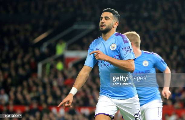 Riyad Mahrez of Manchester City celebrates after scoring his team's second goal during the Carabao Cup Semi Final match between Manchester United and...