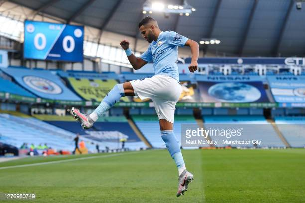 Riyad Mahrez of Manchester City celebrates after scoring his teams first goal during the Premier League match between Manchester City and Leicester...