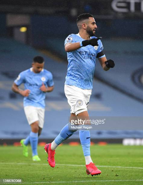 Riyad Mahrez of Manchester City celebrates after scoring his team's fifth goal during the Premier League match between Manchester City and Burnley at...