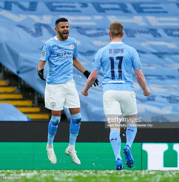 Riyad Mahrez of Manchester City celebrates after scoring his teams first goal with teammate Kevin de Bruyne during the UEFA Champions League Semi...