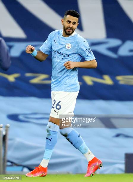 Riyad Mahrez of Manchester City celebrates after scoring their side's fourth goal during the Premier League match between Manchester City and...