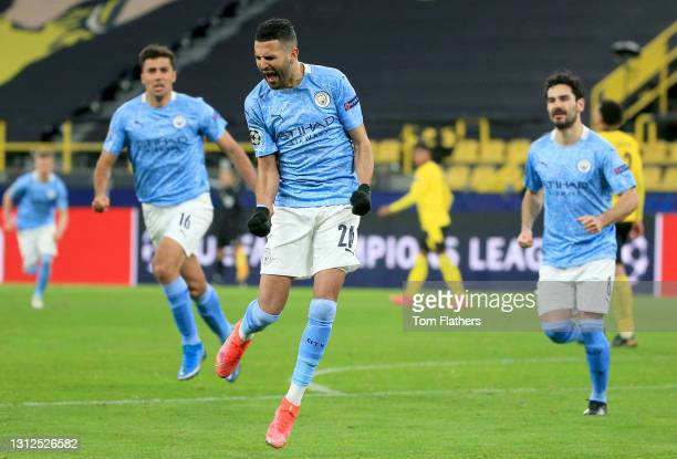 Riyad Mahrez of Manchester City celebrates after scoring their side's first goal from the penalty spot during the UEFA Champions League Quarter Final...