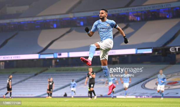 Riyad Mahrez of Manchester City celebrates after scoring their team's first goal during the Premier League match between Manchester City and Burnley...