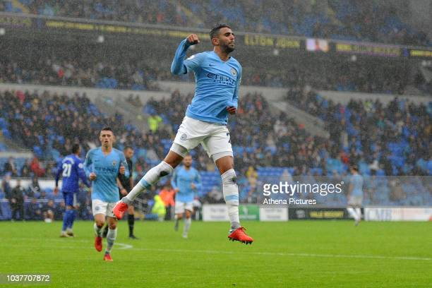 Riyad Mahrez of Manchester City celebrates scoring his side's fifth goal during the Premier League match between Cardiff City and Manchester City at...