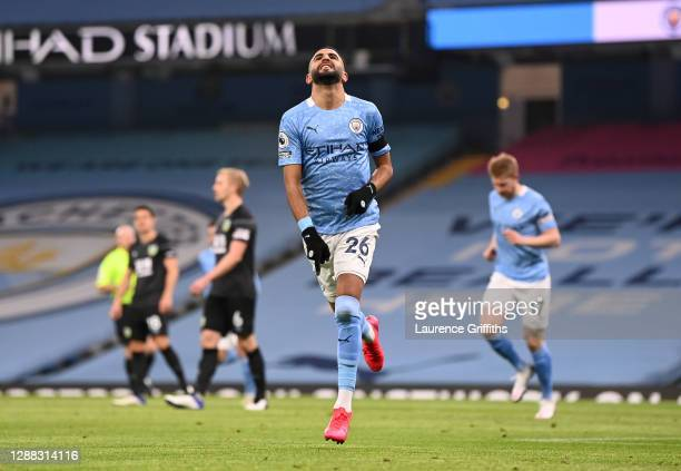 Riyad Mahrez of Manchester City celebrates scoring the opening goal during the Premier League match between Manchester City and Burnley at Etihad...