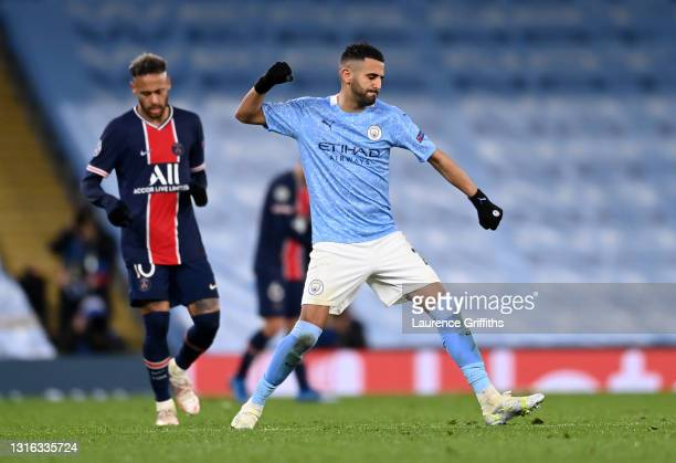 Riyad Mahrez of Manchester City celebrates victory as Neymar of Paris Saint-Germain reacts after the UEFA Champions League Semi Final Second Leg...