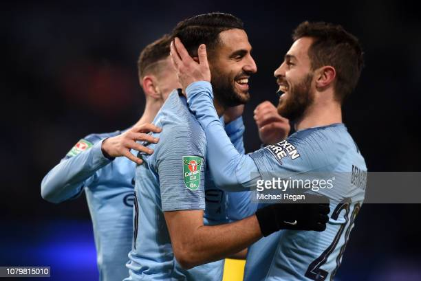 Riyad Mahrez of Manchester City celebrates with Bernardo Silva as he scores his team's ninth goal during the Carabao Cup Semi Final First Leg match...