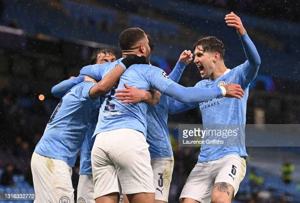 Riyad Mahrez of Manchester City celebrates with Kyle Walker and John Stones after scoring his team's second goal during the UEFA Champions League...
