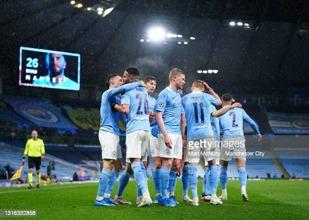 Riyad Mahrez of Manchester City celebrates with Phil Foden after scoring his team's second goal during the UEFA Champions League Semi Final Second...