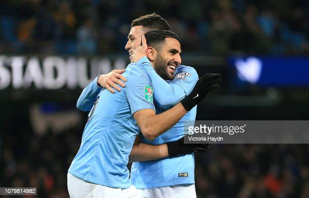 Riyad Mahrez of Manchester City celebrates with Phil Foden as he scores his team's ninth goal during the Carabao Cup Semi Final First Leg match...