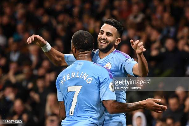 Riyad Mahrez of Manchester City celebrates with Raheem Sterling after scoring his team's second goal during the Premier League match between...