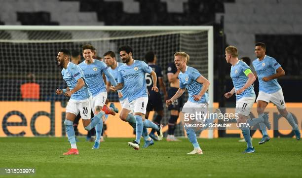 Riyad Mahrez of Manchester City celebrates with team mates after scoring their side's second goal during the UEFA Champions League Semi Final First...