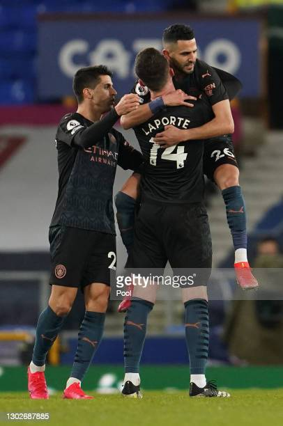 Riyad Mahrez of Manchester City celebrates with team mates Joao Cancelo and Aymeric Laporte after scoring their side's second goal during the Premier...