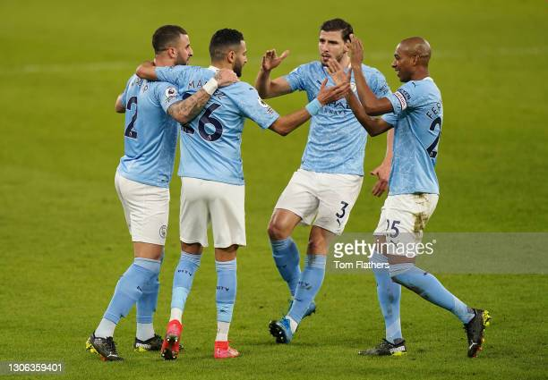 Riyad Mahrez of Manchester City celebrates with team mates Kyle Walker, Ruben Dias and Fernandinho after scoring their side's second goal during the...