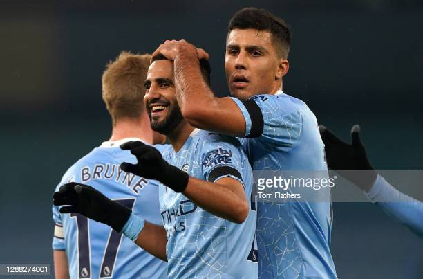 Riyad Mahrez of Manchester City celebrates with teammate Rodri after scoring his team's second goal during the Premier League match between...