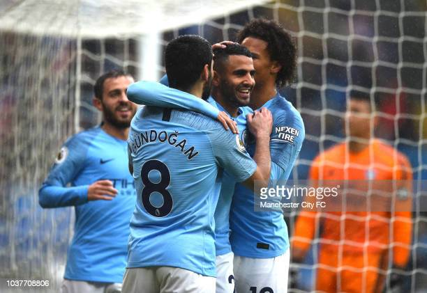 Riyad Mahrez of Manchester City celebrates with teammates after scoring his team's fourth goal during the Premier League match between Burnley FC and...