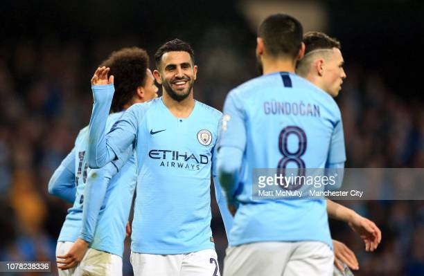 Riyad Mahrez of Manchester City celebrates with teammates after scoring his team's fifth goal during the FA Cup Third Round match between Manchester...