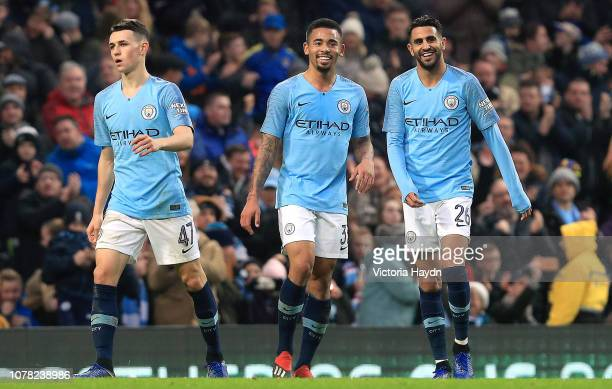 Riyad Mahrez of Manchester City celebrates with teammates after scoring his team's sixth goal during the FA Cup Third Round match between Manchester...