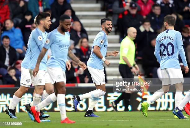 Riyad Mahrez of Manchester City celebrates with teammates after scoring his team's first goal during the Premier League match between AFC Bournemouth...
