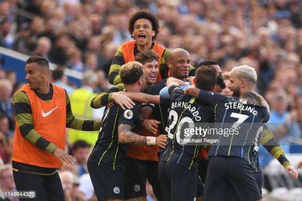Riyad Mahrez of Manchester City celebrates with teammates after scoring his team's third goal during the Premier League match between Brighton Hove...