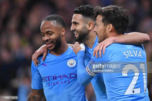 Riyad Mahrez of Manchester City celebrates with teammates after scoring his team's second goal during the Premier League match between Manchester...