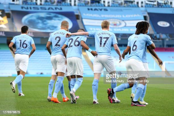 Riyad Mahrez of Manchester City celebrates with teammates after scoring his sides first goal during the Premier League match between Manchester City...