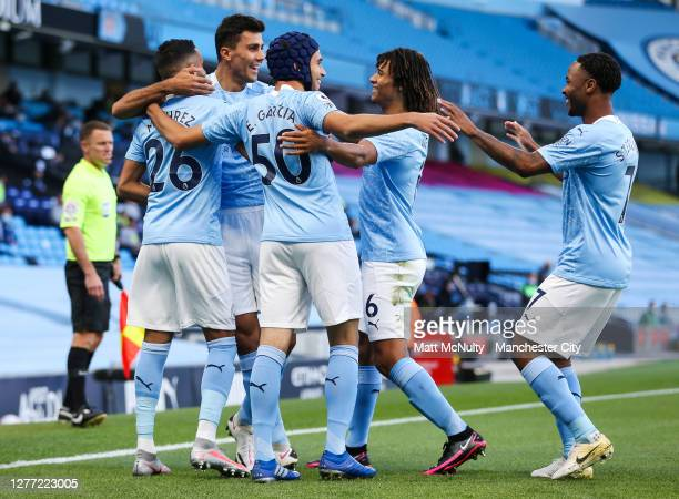 Riyad Mahrez of Manchester City celebrates with teammates after scoring his teams first goal during the Premier League match between Manchester City...