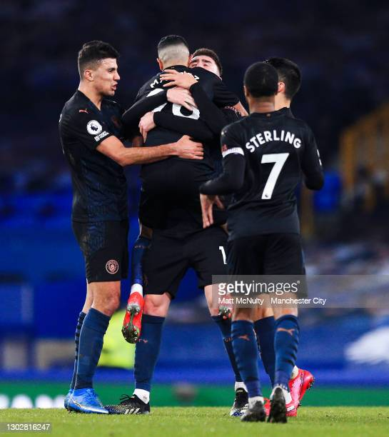 Riyad Mahrez of Manchester City celebrates with teammates after scoring his teams second goal during the Premier League match between Everton and...