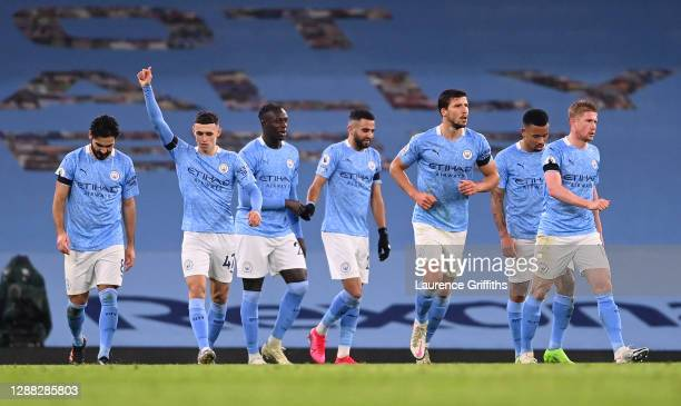 Riyad Mahrez of Manchester City celebrates with teammates after scoring their team's fifth goal during the Premier League match between Manchester...