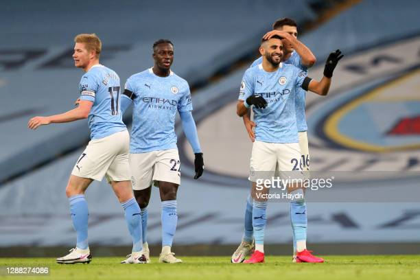 Riyad Mahrez of Manchester City celebrates with teammates Kevin De Bruyne, Benjamin Mendy, and Rodri after scoring his team's second goal during the...