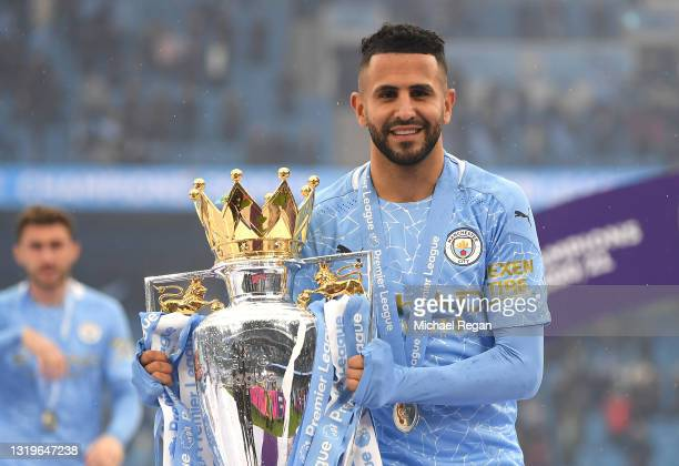 Riyad Mahrez of Manchester City celebrates with the Premier League Trophy as Manchester City are presented with the Trophy as they win the league...