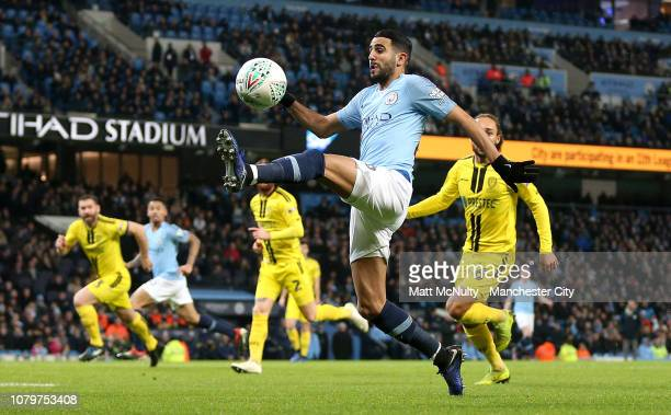 Riyad Mahrez of Manchester City controls the ball during the Carabao Cup Semi Final First Leg match between Manchester City and Burton Albion at...