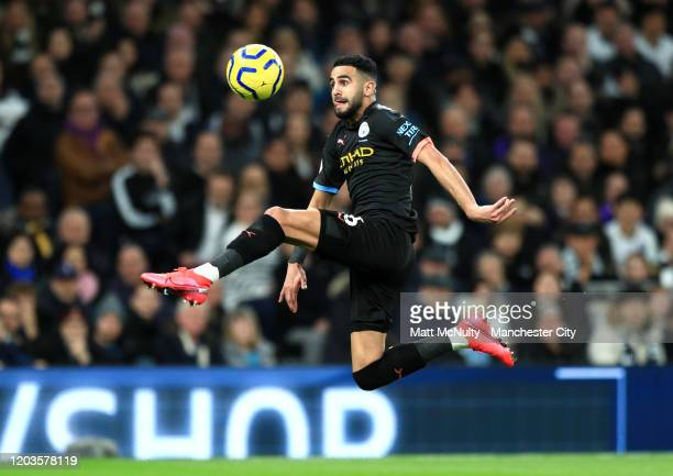 Riyad Mahrez of Manchester City controls the ball during the Premier League match between Tottenham Hotspur and Manchester City at Tottenham Hotspur...