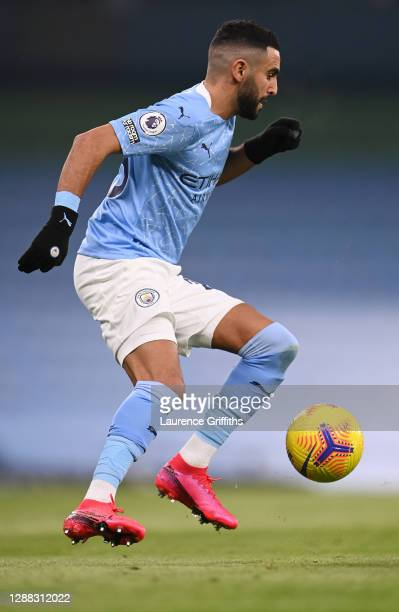 Riyad Mahrez of Manchester City controls the ball during the Premier League match between Manchester City and Burnley at Etihad Stadium on November...