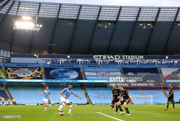 Riyad Mahrez of Manchester City controls the ball under pressure of Kieran Tierney and Dani Ceballos of Arsenal during the Premier League match...